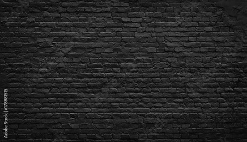 Foto op Plexiglas Historisch geb. Old black brick wall background.