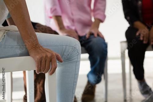 Fototapety, obrazy: Senior friends sitting on chair