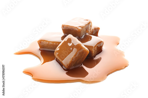 Foto op Aluminium Snoepjes Sweet candies with caramel topping on white background