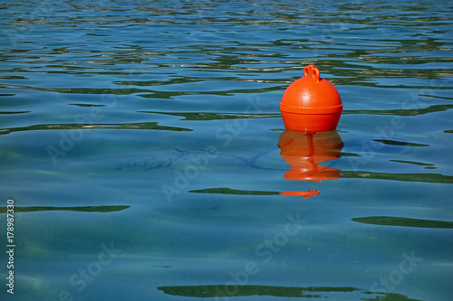 one red buoy and a sea Canvas Print