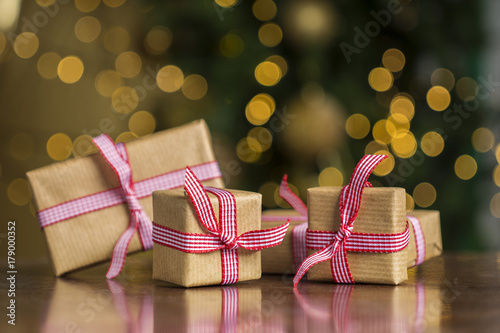 christmas gifts on table lights bokeh background