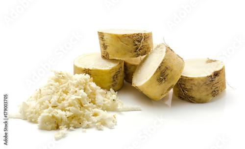 Fotografie, Obraz  Freshly grated mash of horseradish root and sliced circles isolated on white bac