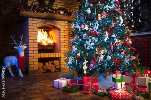 Fototapeta Christmas home interior with tree and fireplace obraz na płótnie