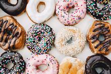 Donuts In Multicolored Glaze A...