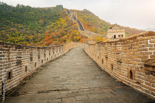 Foto op Canvas Chinese Muur China The great wall distant view compressed towers and wall segments autumn season in mountains near Beijing ancient chinese fortification military landmark in Beijing, China.