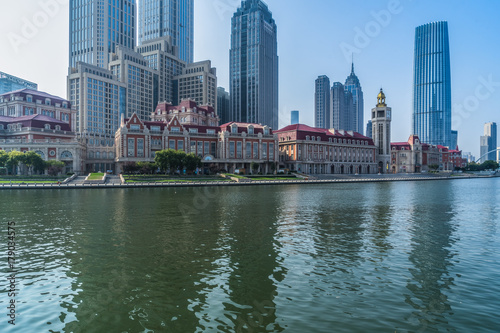 Canvas Prints Cappuccino Tianjin Hai river waterfront downtown skyline against blue sky,China.
