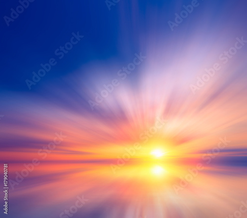 Poster Violet Sea sunset with bright sun and colorful clouds.