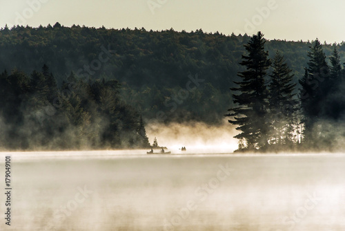 Canada Ontario Lake of two rivers Canoe Canoes foggy water sunrise fog golden ho Canvas Print