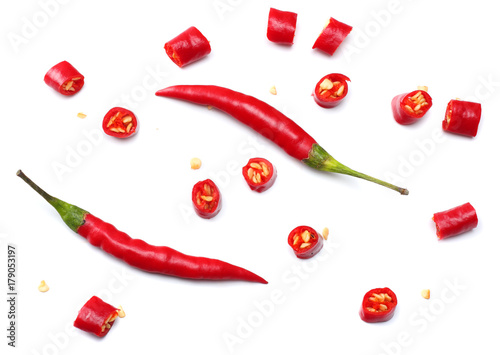 Foto auf Gartenposter Hot Chili Peppers sliced red hot chili peppers isolated on white background top view