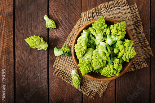 Cabbage romanesco on a dark wooden background. Top view