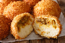 Homemade Japanese Bread Stuffed With Curry Kare Pan Macro On Paper. Horizontal