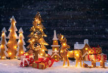 Christmas Backgound With Illuminated Wooden Village And Christmas Tree