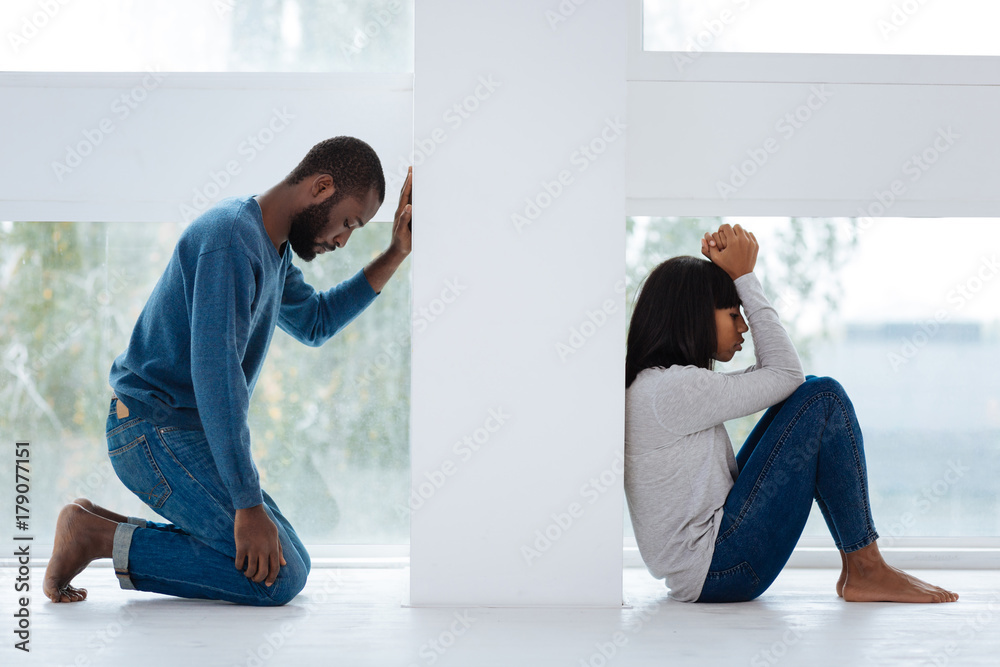Fototapety, obrazy: Sad man regretting the quarrel with his girlfriend