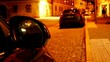 Rear-view Mirror of Car in the Night Town. Time Lapse.