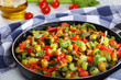 caponata with vegetables in a skillet
