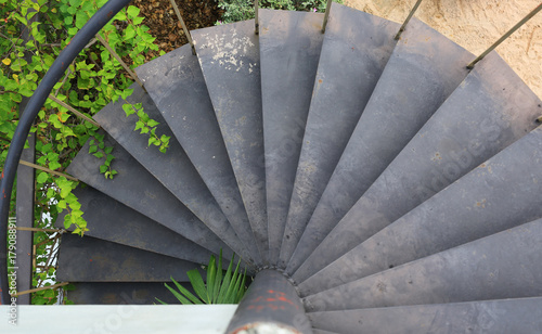 Photo Stands Stairs Spiral metal staircase outdoors.