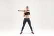 Leinwanddruck Bild - Young woman doing aerobic exercising and looking at camera