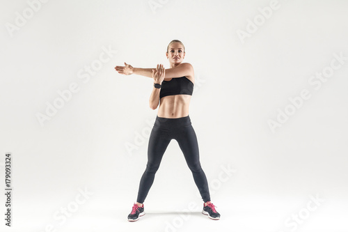 Young woman doing aerobic exercising and looking at camera Canvas Print