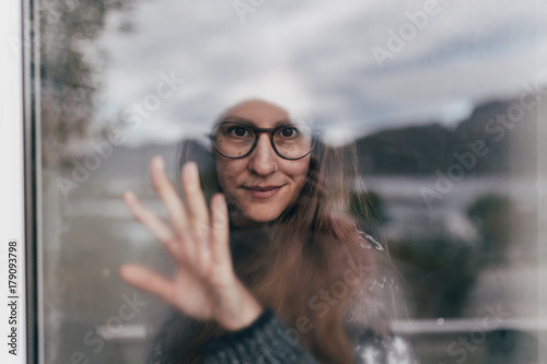 Woman in glasses at window
