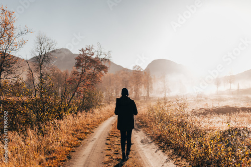 Spoed Foto op Canvas Europa Person walking on road in woods