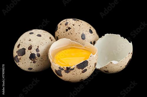 Quail eggs on black