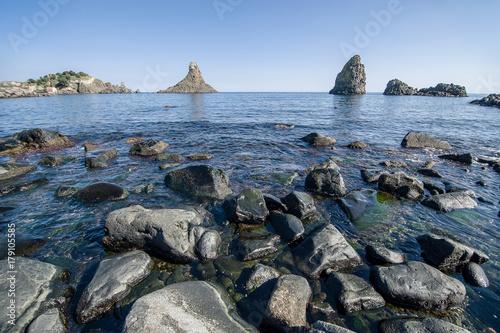 """Photo """"Faraglioni"""" the famous cyclops island in Acitrezza, Sicily"""