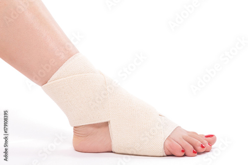 Photo studio shot female ankle tied with an elastic bandage