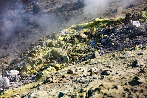 Foto op Aluminium Aubergine Sulfur haze and crystals on the rocks. Volcano or Vulcano Island in the archipelago of Aeolian Islands close to Sicily - Italy.
