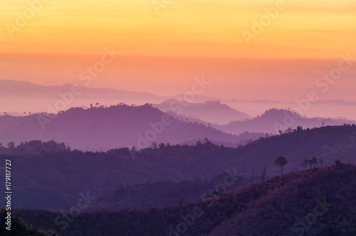sunrise high angle view in early morning over rainforest mountain in thailand
