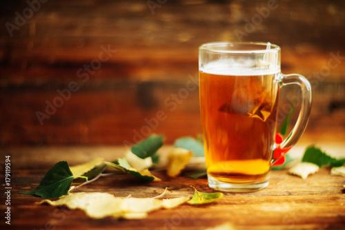 Recess Fitting Tea Glass of hot fruit tea. Book,apple,leaves. Autumn,fall mood. Comfort home.