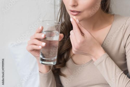 Fototapeta woman taking pill obraz