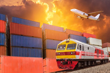 Global Business With Commercial Cargo Freight Train And Container Cargo Stack At The Dock During Cargo Plane Flying Above On Sunset Time. Logistics Transportation Delivery Import Export Concept.