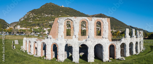 Poster Rudnes Gubbio, one of the most beautiful small town in Italy. Drone aerial view of the ruins of the Roman theater
