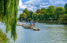 Moored Boats On The River Thames In Summer On A Overcast Day, Richmond London U.K