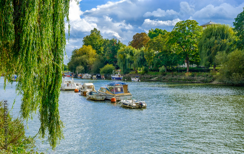 Fotografie, Obraz  Moored boats on the river Thames in summer on a overcast day, Richmond London U
