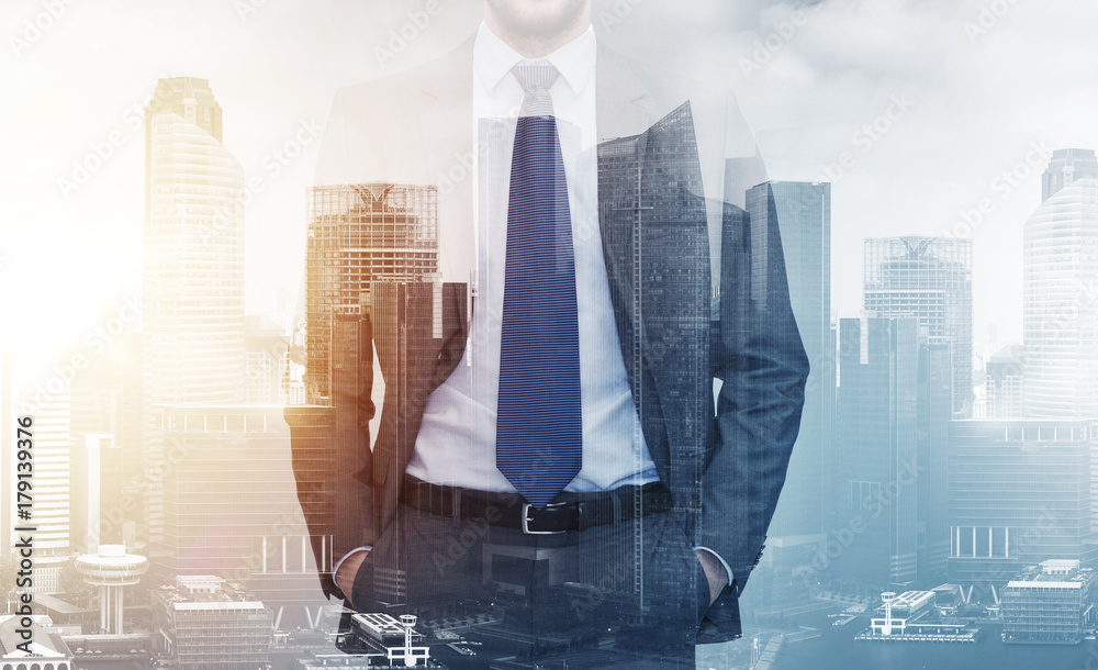 Fototapeta close up of businessman over city buildings