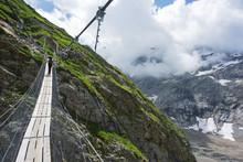 Hiker On A Suspension Bridge, Chamonix, Rhone Alpes, Haute Savoie, France