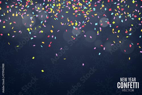 many falling multicolored confetti on a dark blue background celebratory background on birthday new
