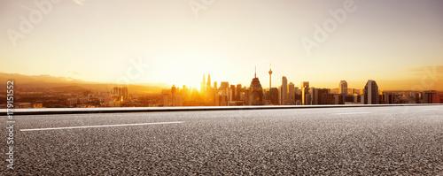 Canvas Prints Kuala Lumpur empty asphalt road with modern cityscape