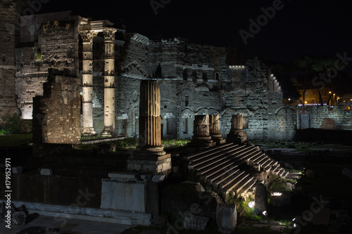 The Trajan's Forum (Foro Di Traiano) with ruins of ancient architecture at night, Rome, Italy