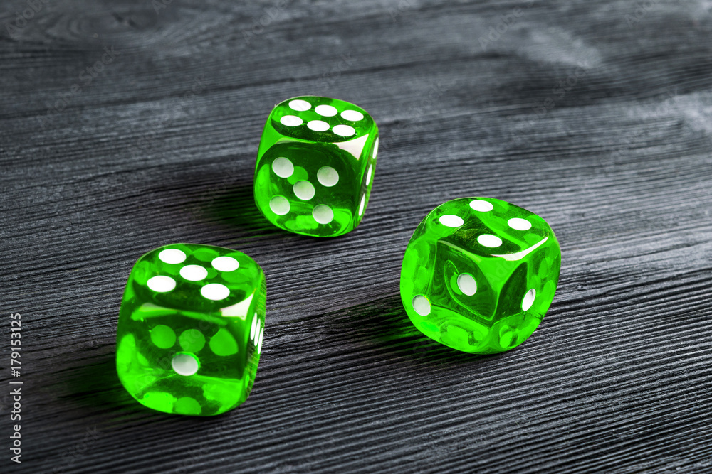 risk concept - playing dice at black wooden background плакат