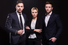 Picture Of Young Trio Of Office Workers Standing