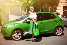 Young Hipster Woman In Green Skirt Standing Near Car