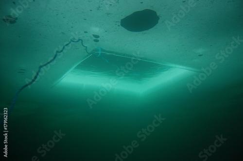 Staande foto Duiken plongée sous glace lac Montriond