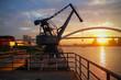 Port quay cranes sunset