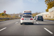 white car with porter drives on a german motorway