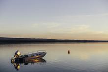 Boat And Buoy Reflection At Su...