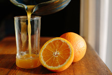 Pouring A Glass Of Fresh Squeezed Orange Juice