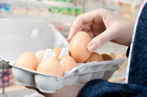 Woman buys eggs in the supermarket