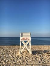 A Lifeguard Chair On The Beach...